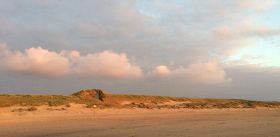 zonnegloed over de duinen